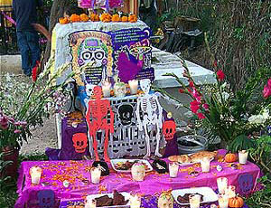 Gravesite adorned with candles and flowers