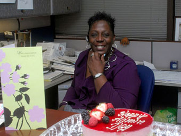 Armed Services Blood Program Office administrative specialist receives cards, cake and thanks for Administrative Professionals Day.