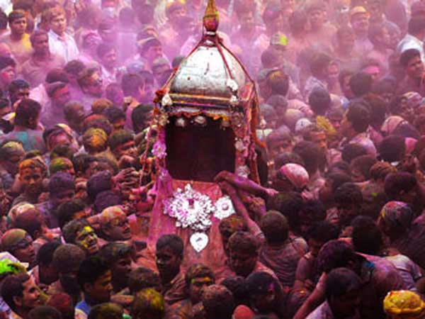 Followers carrying the palanguins of Lord Krishna and Ghunusa - Holi celebrated in  Barpeta.