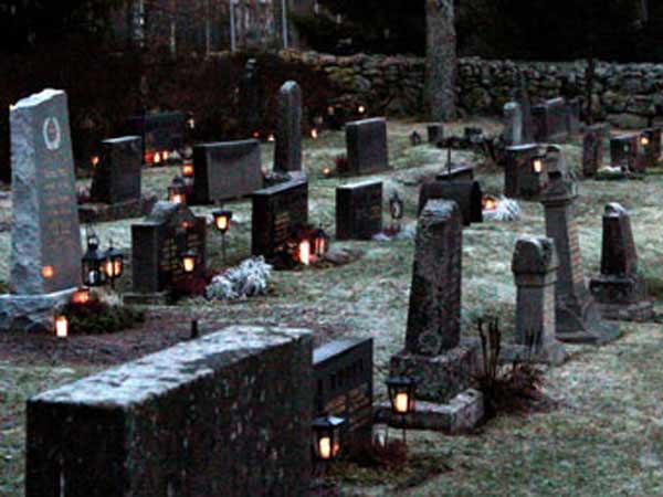 Cemetery at dusk with candles.