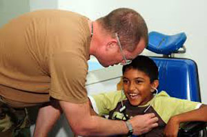 Young hispanic child being treated by doctor