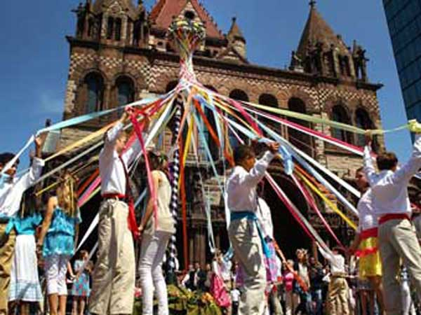 Children dancing around May pole.