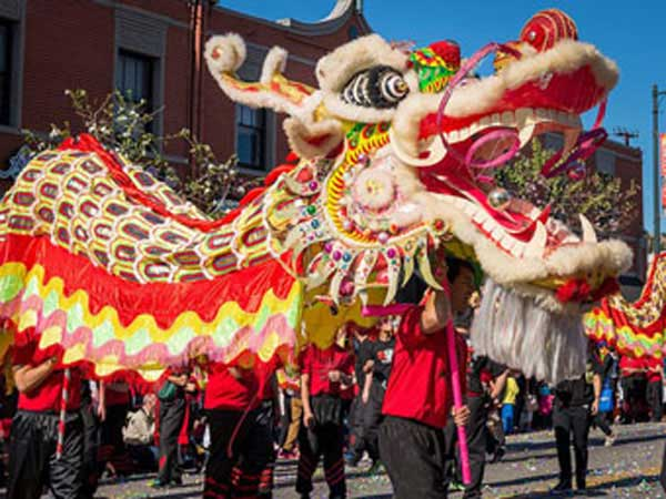 chinese new year parade with dragon in downtown los angeles