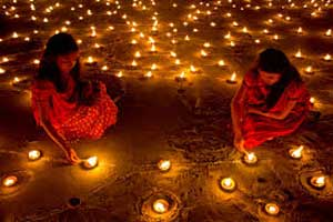 Young Indian girls lighting candles