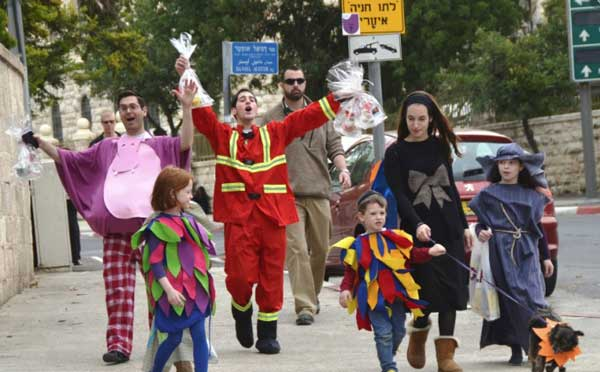 Family walking down street in Isreal celebrating Purim.