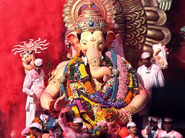 Lord Ganesh on float in festival parade.