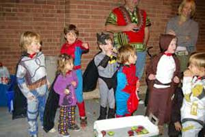 Young trick or treators in costumes