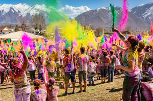People celebrating with colors in Mountains