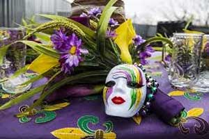 Face masks, beads, and festivities for Fat Tuesday