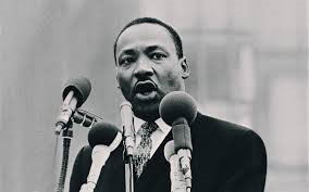 Dr. Martin Luther King speaking to large audience