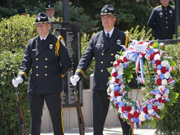 Peace Officers Honor Guard stand watch over memorial service.