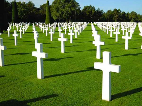 White marble crosses at grave sites in Luxembourg American Cemetery and Memorial in Luxembourg.