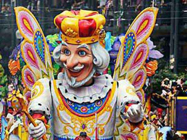 Large float with King of the Carnival riding atop in New Orleans, Louisiana Mardi gras celebrations.