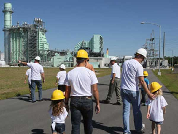 Dads sharing their work at power plant with kids.