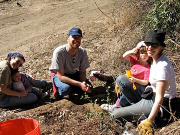 Family planting tree in Runyon Canyon.