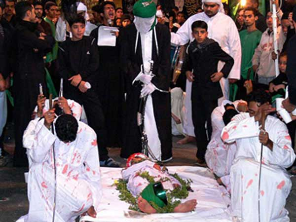 Reenactment of death of Imam Hussain's martyred son in Manama, Bahrain.
