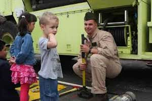 Fire fighter showing kids truck