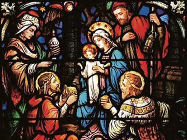 Stain glass of the three wise men visiting Jesus.