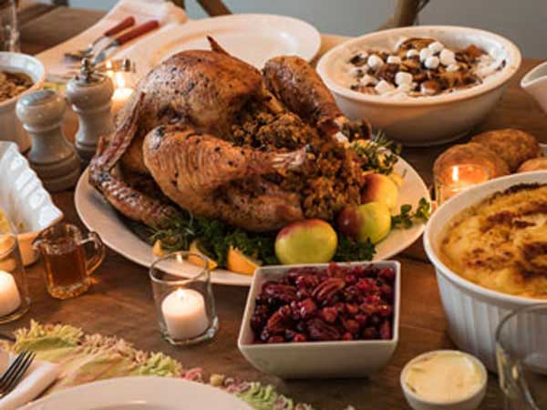 Bountiful Thanksgiving dinner with turkey, stuffing, cranberries and all the fixings.