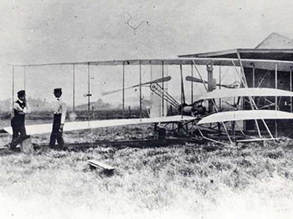 Wright brothers Orville on left and Wilbur on the right in 1904 with the Wright Flyer 2 plane at Huffman Prairie.